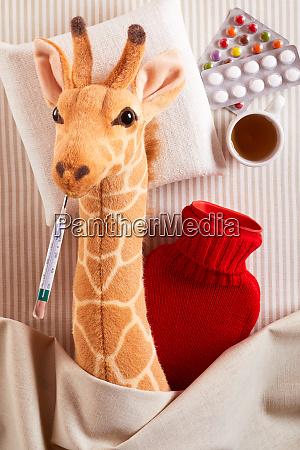 sick toy giraffe running a fever