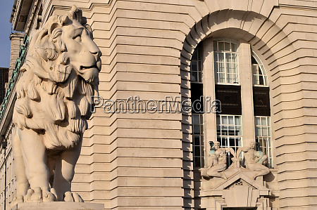 lion as facade decorations in london