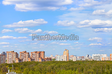 blue sky with clouds over city