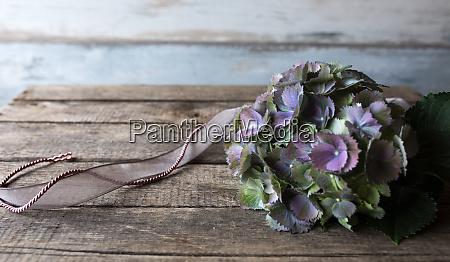vintage flowers on wooden background