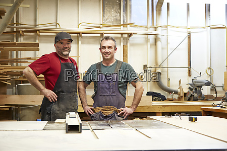 carpenters smiling in workshop