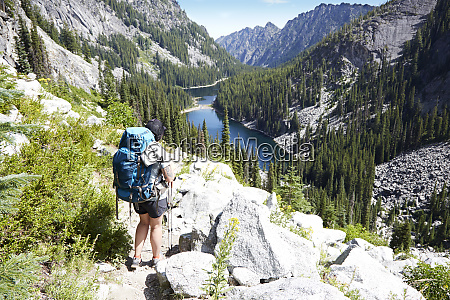 hiker walking on rocky hillside