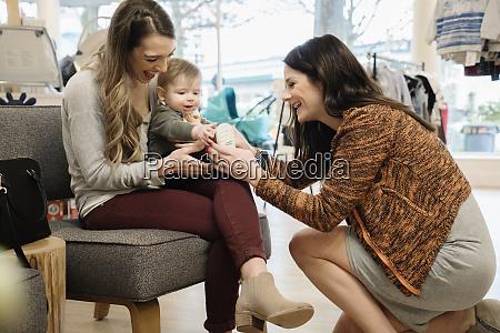 caucasian women and baby boy shopping