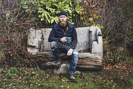 bearded man wearing black beanie sitting