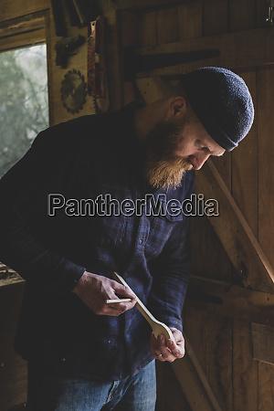 bearded man wearing black beanie standing