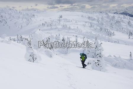 caucasian, snowshoer, walking, up, snowy, hillside - 26903213