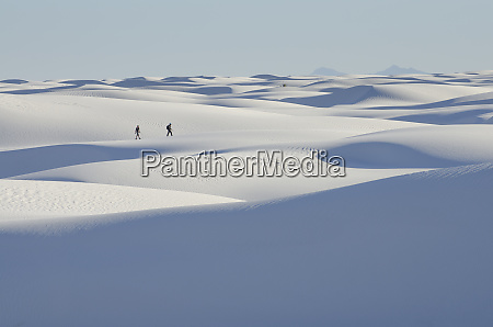distant people walking on snowy landscape