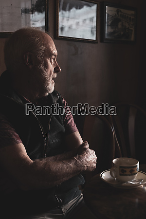 bearded man sitting at a table