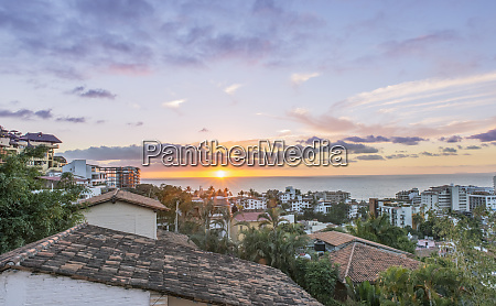 aerial view of city rooftops sunrise