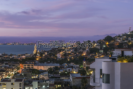 aerial view of illuminated cityscape at