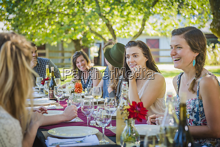 caucasian women talking at table at