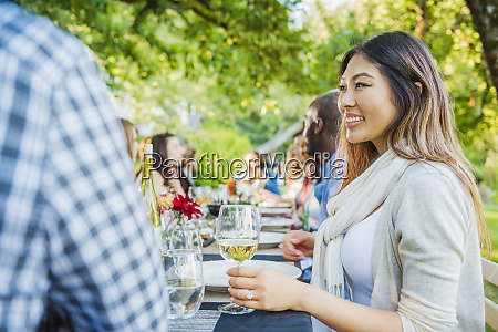 woman enjoying wine at party outdoors