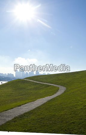 sun shining over paved road on