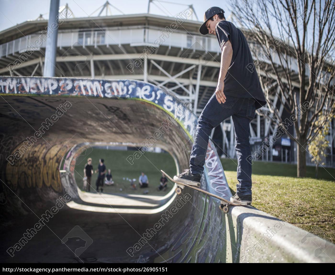 caucasian, man, skating, on, half, pipe - 26905151
