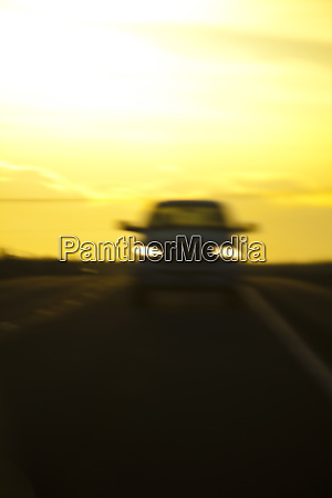 blurred view of car on road