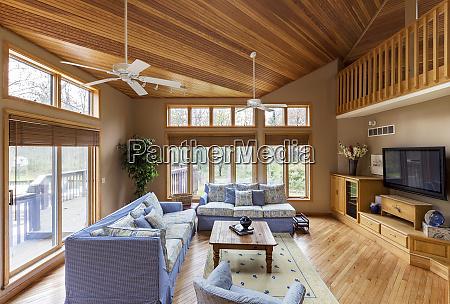 hardwood floor and ceilings in living