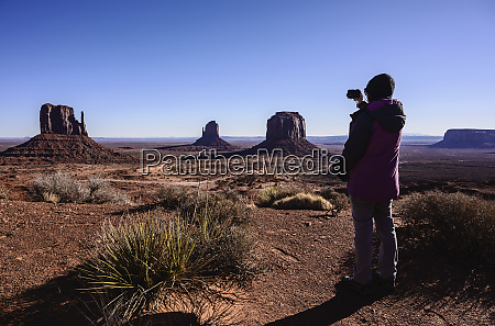 woman photographing monument valley in arizona
