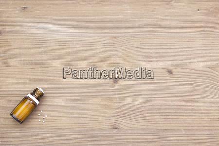 pill bottle globules on wood