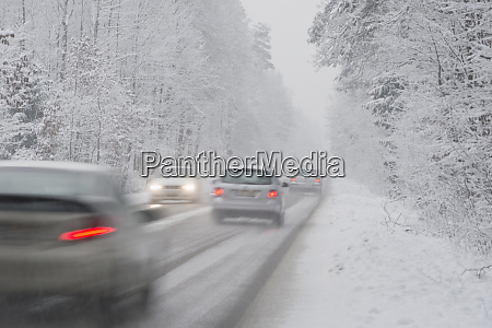 cars driving on country road in