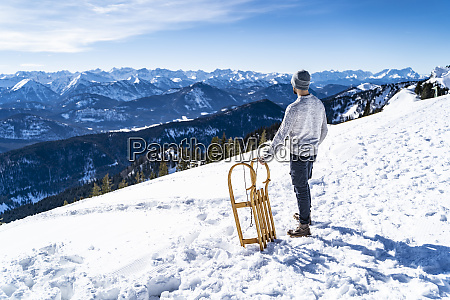 germany bavaria brauneck man with sledge