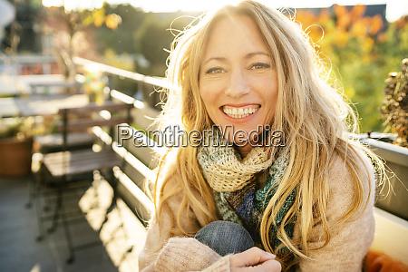 portrait of happy blond mature woman