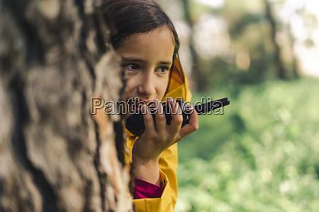 portrait of girl with walkie talkie