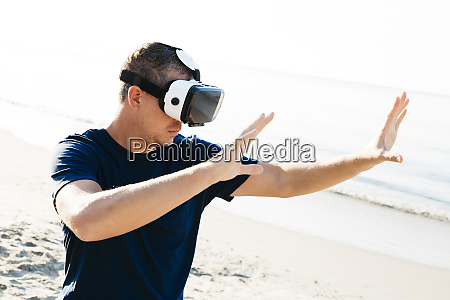 man wearing vr glasses on the