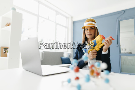 female scientist holding water gun studying