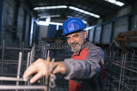 portrait of confident worker wearing hard