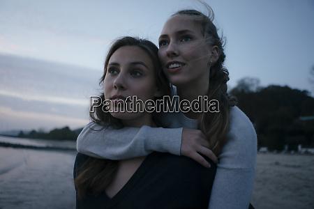 germany hamburg two teenage girls hugging