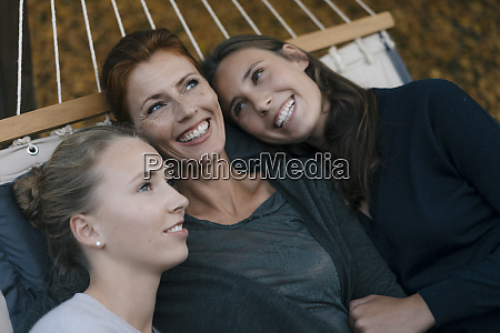happy mother with two teenage girls