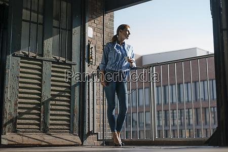 germany hamburg speicherstadt businesswoman with cup