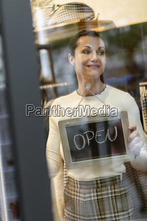 mature woman standing in shop