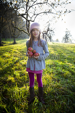 portrait of smiling girl standing on