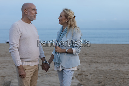 spain barcelona happy senior couple hand