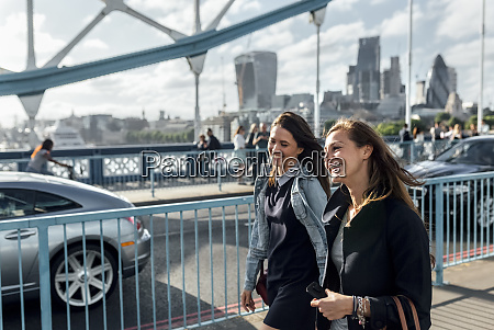 uk london two happy women walking