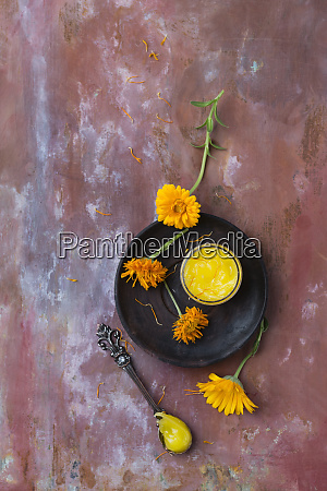 dried marigold blossoms and marigold salve