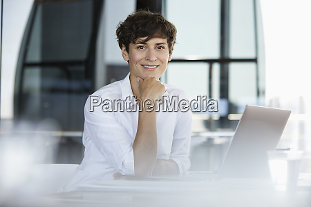 portrait of confident businesswoman sitting at