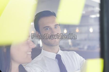 businessman with colleague brainstorming with post