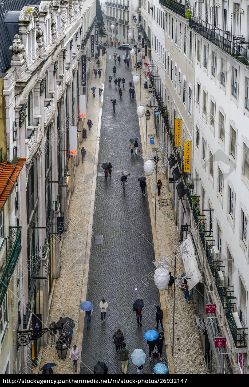 pedestrians, with, umbrellas, walk, the, narrow - 26932147