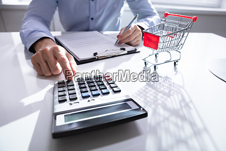 close up of man calculating shopping