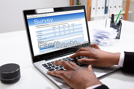 businesswoman filling online survey form on
