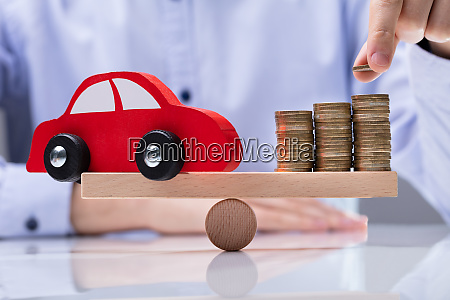 red car and stack of coins