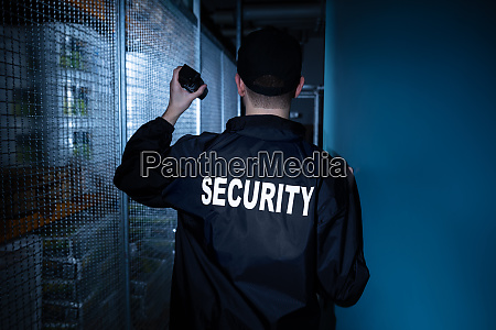 security guard standing in the warehouse
