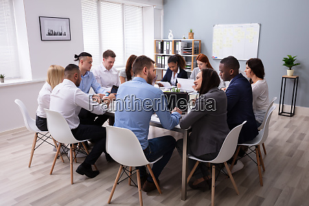 multi ethnic business people having business