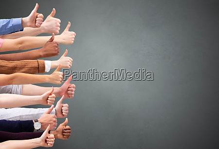 people hand showing thumb up sign