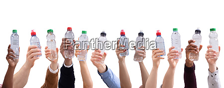 different people holding water bottles in