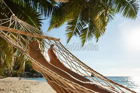 womans feet on hammock hanging on