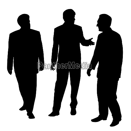group of three businessmen walking and
