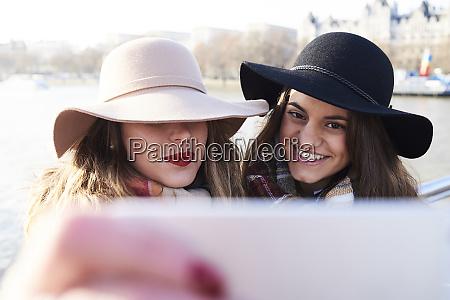 uk london two women wearing floppy